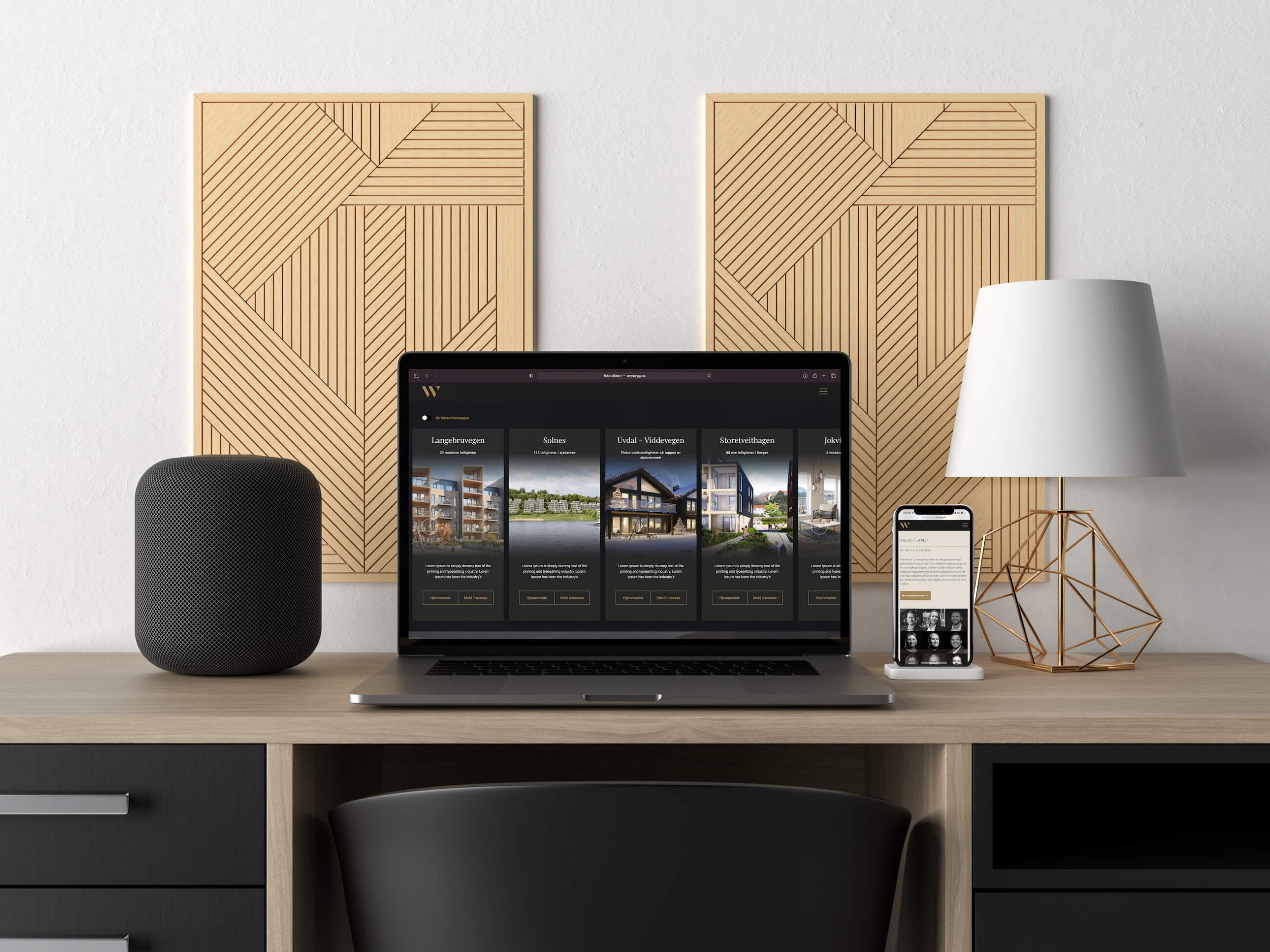 MacBook og iPhone med W Nybygg sin portal